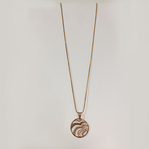 Circle pendant with diamante details, hanging on a delicate necklace