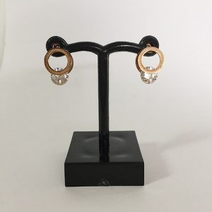 Double hoop earrings with pattern finish and featuring a diamante at the bottom