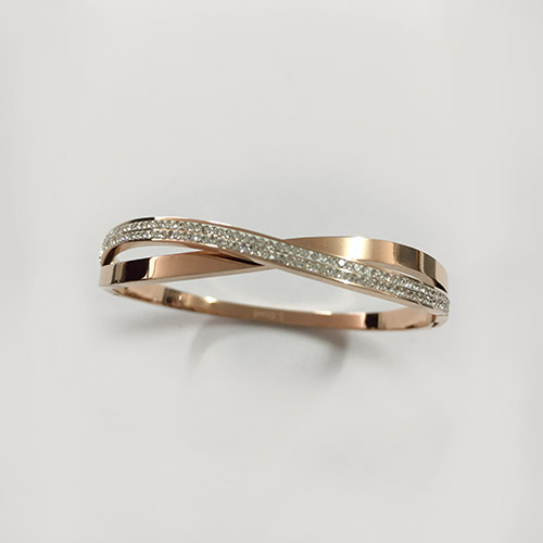Diamante cross-over bangle, plated in rose gold