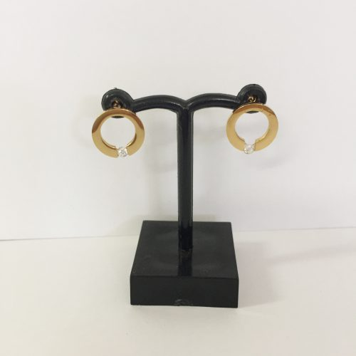 gold-plated, stainless steel earrings in a round style and finished off with diamantes at the bottom