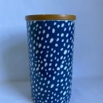 bone china canister with a blue background and white spotted pattern