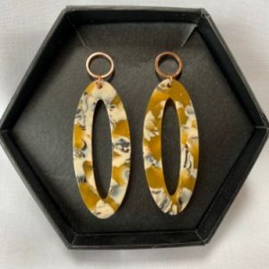 Madella designs oval drop earrings in muted mustard colours
