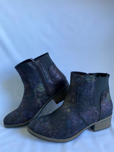 multi-fleck coloured leather ankle boot with elastic gustics and inside zips for easily putting on an taking off