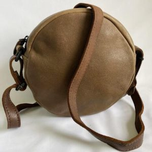 Round leather shoulder bag with contrasting coloured strap